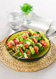 Vegetables skewers. With herb, tomato and zucchini Royalty Free Stock Image
