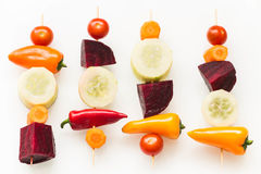Vegetables skewers on the white background. Vegetables skewers on the bright background / the concept of healthy lifestyle Stock Images