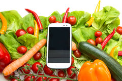 Vegetables and a Smartphone Stock Image