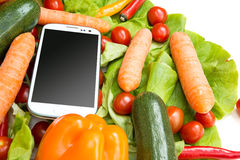 Vegetables and a Smartphone Royalty Free Stock Images