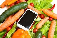 Vegetables and a Smartphone Royalty Free Stock Photos