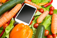 Vegetables and a Smartphone Royalty Free Stock Photography