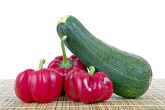 Vegetables. Some peppers and a zucchini, isolated on white background royalty free stock photo