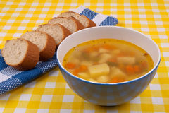 Vegetables soup and bread Royalty Free Stock Photography