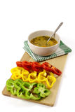 Vegetables soup and sliced colorful peppers Royalty Free Stock Photos