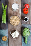 Vegetables and soy products. Ingredients for vegan food, presents on rustic wood Stock Photo