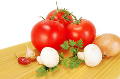 Vegetables and spaghetti Stock Images