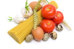 Vegetables, spaghetti and egg on a white background close-up Stock Image