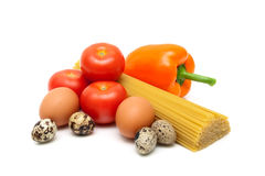 Vegetables, spaghetti and eggs on a white background Stock Images