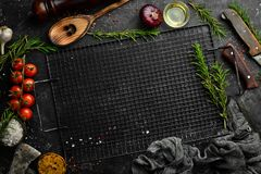 Free Vegetables, Spices And Herbs On A Black Stone Background. Kitchen Background. Top View. Royalty Free Stock Photo - 211058275
