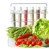 Vegetables and spices on kitchen table stock photo