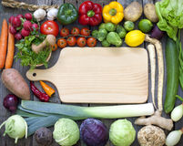 Vegetables and spices vintage border. And empty cutting board Stock Photography