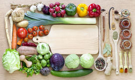 Vegetables and spices vintage border. And empty cutting board Royalty Free Stock Images