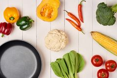 Vegetables and spices vintage border and empty frypan.  Royalty Free Stock Image