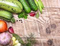 Vegetables and spices on wooden background Royalty Free Stock Images