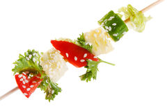 Vegetables on a spit Stock Photo