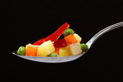 Vegetables in a spoon Stock Image