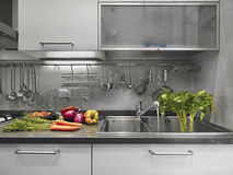 Vegetables on steel worktop in the kitchen Royalty Free Stock Images