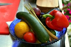 Vegetables still life in blue plate Stock Photos