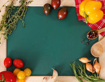 Vegetables still life with green board Stock Photo
