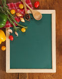 Vegetables still life with green board Royalty Free Stock Images