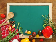 Vegetables still life with green board Royalty Free Stock Photos