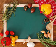 Vegetables still life with green board Stock Image