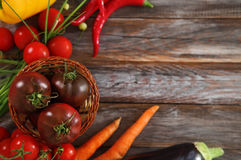 Vegetables still life in wooden background Stock Photography