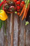 Vegetables still life in wooden background Stock Photo