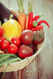 Vegetables still life on wooden background Stock Photo