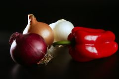 Vegetables still with onion and pepper Royalty Free Stock Image