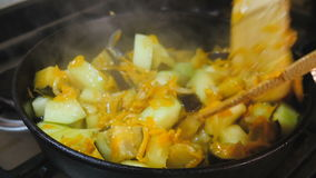 Vegetables stirred in a pan. stock video