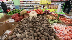 Vegetables in the store panoramic shot. Potatoes, tomatoes stock footage