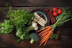 Vegetables straight from the garden, carrots, radish, broccoli, asparagus, tomatoes royalty free stock image
