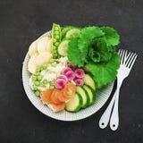 Vegetables summer fruit detox bowl. Vegetarian healthy food. Salads, lettuce leaves, raspberries, green peas, cucumber royalty free stock photo