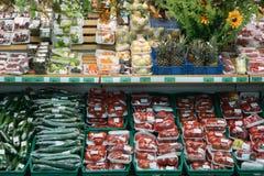 Vegetables in supermarket. Motley vegetables in big supermarket Stock Photo