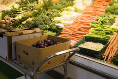 Vegetables on a supermarket shelf Stock Image