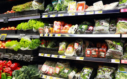 Vegetables at the supermarket. A view of a wide variety of fresh organic vegetables at a supermarket aisle Royalty Free Stock Photography
