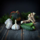 Vegetables on a surface from old boards in style  rustic. Vegetables on a surface from old boards with a dark background in style a rustic Stock Image