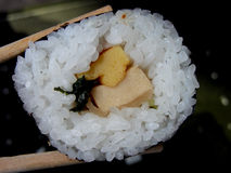Vegetables sushi. A vegetables sushi and two chopsticks Stock Photos
