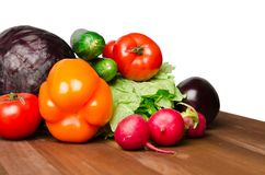 Vegetables on a table isolated on a white Royalty Free Stock Photos