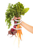 Vegetables tape measure and hand Royalty Free Stock Photos
