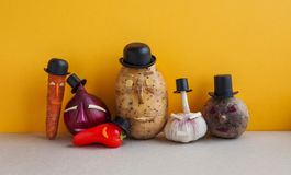 Vegetables team. Mister potato red onion beetroot garlic pepper carrot. Old fashion style characters organic plants. Funny faces black hats. Yellow wall Royalty Free Stock Image