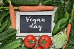 Vegetables and text vegan day Stock Photos