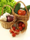 Vegetables in three wickers Royalty Free Stock Photos