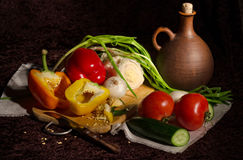 Vegetables to make the salad and a pitcher. Royalty Free Stock Image