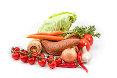 The vegetables together. Different vegetables such as carrots, tomatoes, peppers, chicory, garlic Stock Image
