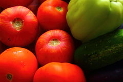 Vegetables of tomato, cucumber, pepper. Close up shows the tomatoes, cucumbers, peppers Royalty Free Stock Photos
