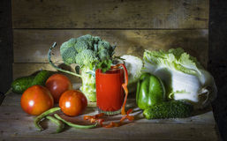 Vegetables and tomato juice. Still-life with fresh vegetables and tomato juice Stock Photography