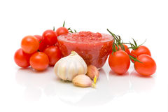 Vegetables and tomato sauce on a white background Royalty Free Stock Photography